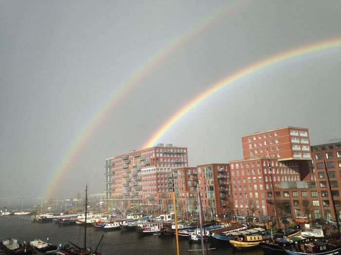 Westerdok Architecture Beauty In Nature Building Exterior Built Structure City Day Double Rainbow Mode Of Transport Moored Multi Colored Nature Nautical Vessel No People Outdoors Rainbow Scenics Sky Transportation Water Westerdokskade
