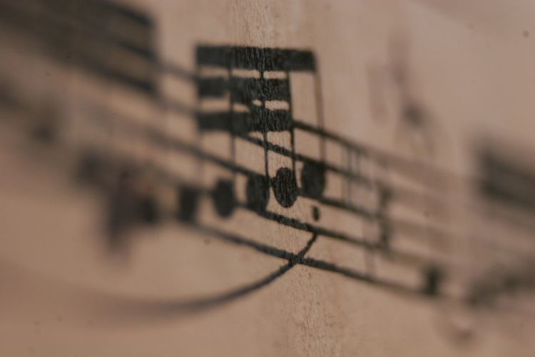 notes Brown Built Structure Day Focus On Foreground Music No People Notes Paper Selective Focus Sheet Music Slur