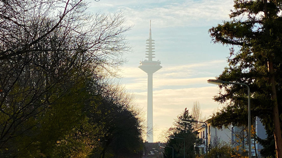 View of communications tower against cloudy sky