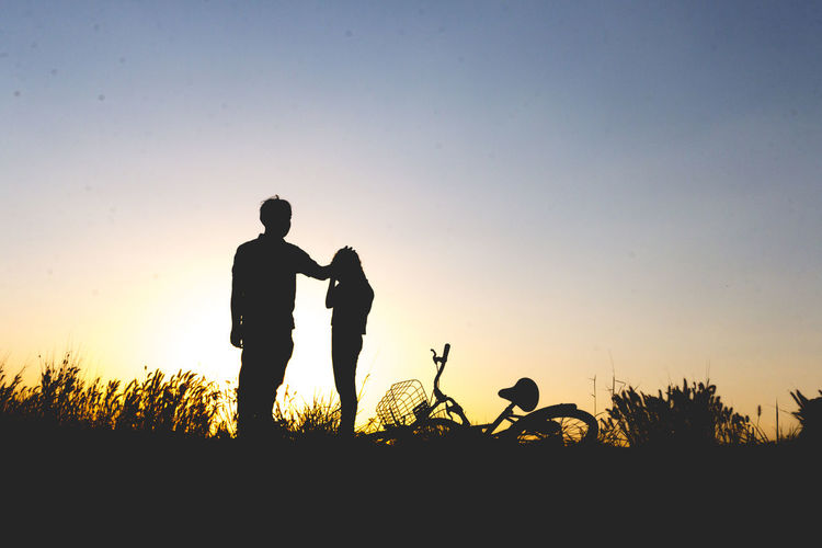 Bonding Clear Sky Day Friendship Full Length Leisure Activity Lifestyles Mammal Men Nature Outdoors People Real People Silhouette Sky Sunset Togetherness Two People