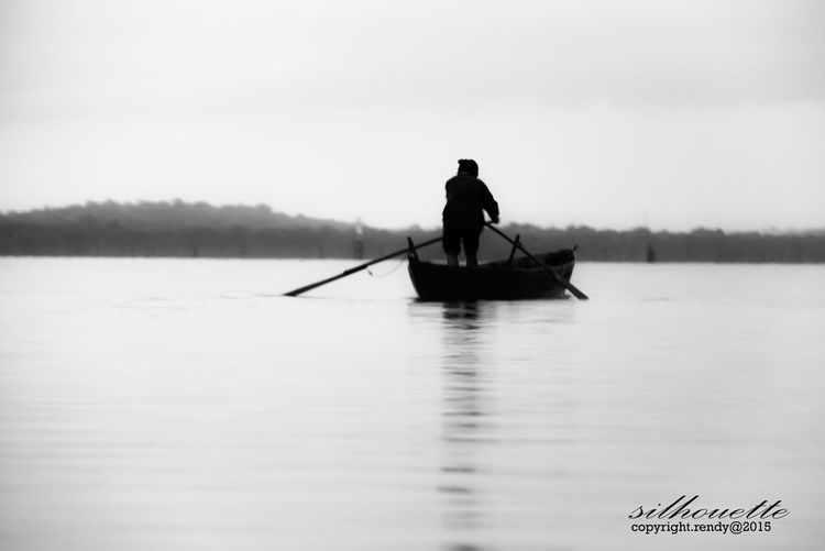 Transportation Boat Water Silhouette Tranquility Mode Of Transport Beachphotography Humaninterestphotography Wonderfulindonesia Pesonaindonesia_id Humaninterest_indonesia Monochrome_Monday
