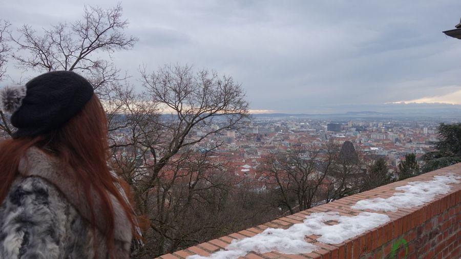Woman looking at city during winter