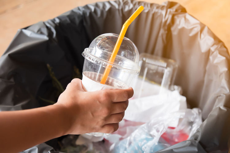 hand holding plastic garbage Junk Rubbish Trash Cup Environment Garbage Plastic Pollution Recycle Recycling