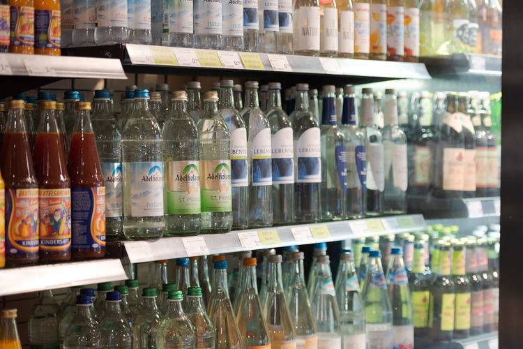 Row of bottles on display at store