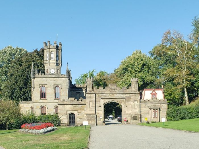 Castle Entrance Entrance Gate Allegheny Cemetery Burial Pennsylvania Pittsburgh Tree Clear Sky Sky Architecture Grass Built Structure Building Exterior Cemetery Historic Place Of Burial Clock Tower Gate Historic Building