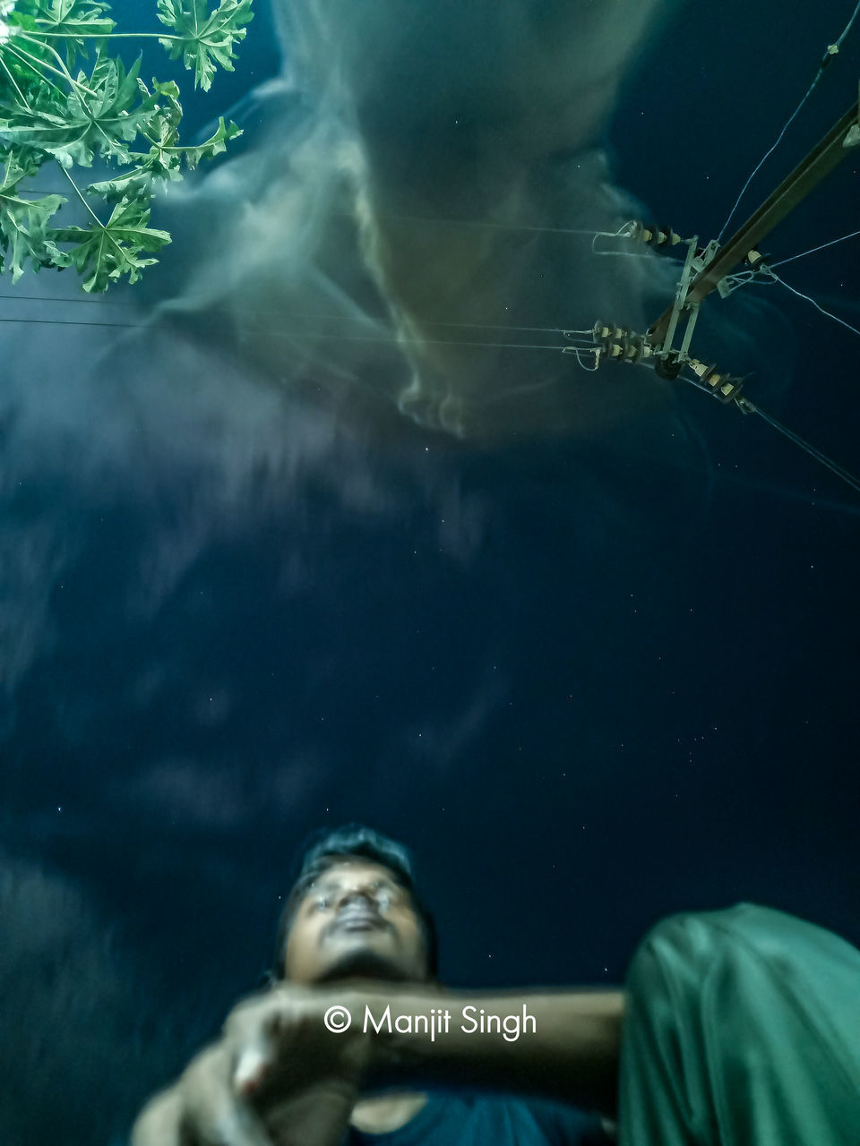 REFLECTION OF MAN IN SEA