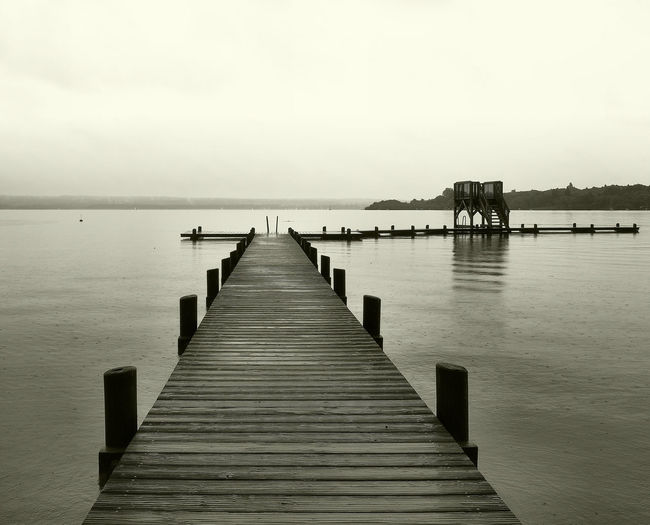 Beauty In Nature Blackandwhite Boardwalk Calm Diminishing Perspective Eye4photography  EyeEm Nature Lover Horizon Over Water Idyllic Jetty Long Nature Ocean Outdoors Pier Rainy Days Rippled Scenics Sea Sky The Way Forward Tranquil Scene Tranquility Water Wood - Material