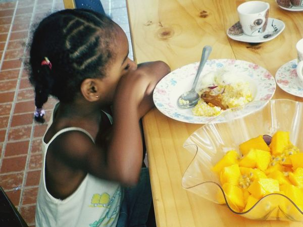 Food And Drink One Child Only Sitting At The Table Eating Pieces of PawPaw The Week On EyeEm
