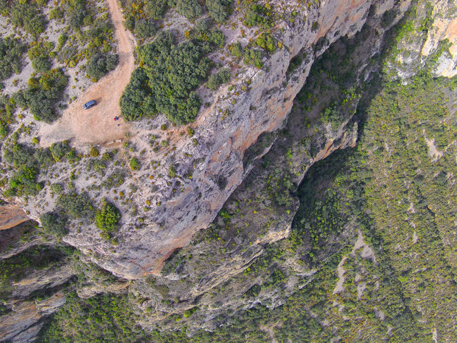 Drone  Drone Moments Nogera Pallaresa River Gorge In The Region Of La Noguera Province Of Lérida Rock Formation Train Of The Lakes Route From Lérida To The Seu Of Urgell Beauty In Nature Day Drone Photography Landscape Nature No People Outdoors Physical Geography Rocky Mountains Scenics Textured  Travel Destinations Tree