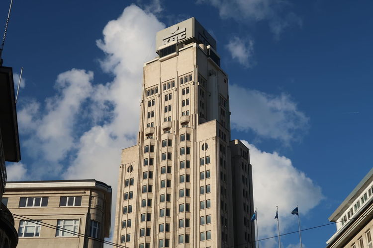 Antwerp, Belgium - December 4, 2018, KBC bank in Atwerp the second largest bank in Belgium, focusing on private persons and small and medium-sized enterprises in Belgium, Ireland and Central Europe KBC Bank Antwerp Belgium Bank Building Exterior Built Structure Sky Cloud - Sky Low Angle View City Sunlight Outdoors Tower Office Building Exterior
