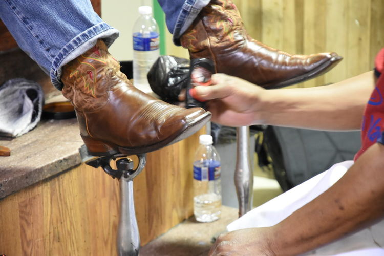 Shine. Boots Business Business Trip Close-up Commercial Countryside Cowboy Boots Cropped Enploy Focus On Foreground Holding Lifestyles Marketplace Midsection Overexposed Person Polish Preparation  Reading Terminal Market Selective Focus Shiny Skill  Unrecognizable Person Work