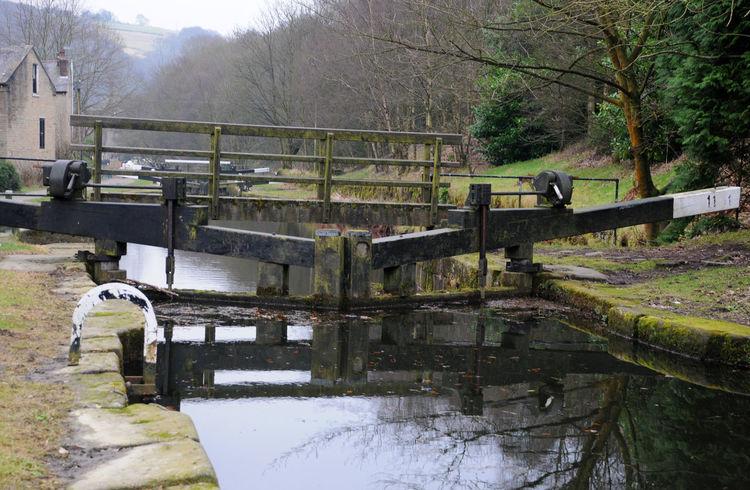 lock gates on a canal in hebden bridge Hebden Bridge Architecture Beauty In Nature Bridge - Man Made Structure Built Structure Canal Day Lock Gates Nature No People Outdoors Railing Sky Tree Water
