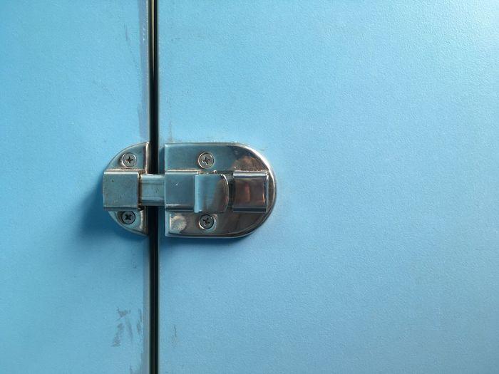 Close-Up Of Metallic Latch On Blue Door