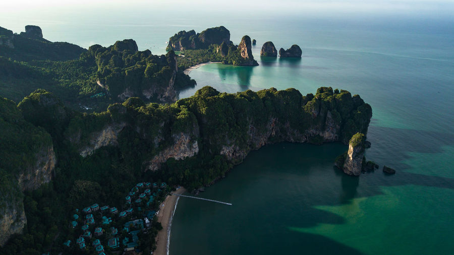aerial view landscape of Palm tree in Krabi Thailand Sand ASIA NGA Nature Water Background Sea Summer Drone  Ocean Turquoise Cancun Island Sky Krabi View Landscape Mountain Beach Coast Calm Aerial Panoramic Phang Shore Paradise Andaman Blue Phi Thailand Beautiful Travel Forest Top Bay White Wave Vacation Tourism Tropical Seaside Scenics - Nature Beauty In Nature Rock Tranquil Scene Tranquility Solid Rock - Object Rock Formation Day No People Idyllic High Angle View Non-urban Scene Land Outdoors Turquoise Colored