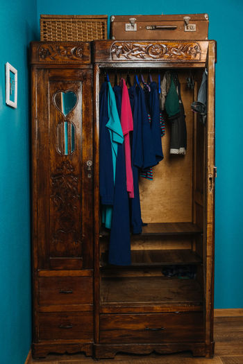 Clothes hanging on wooden door at home