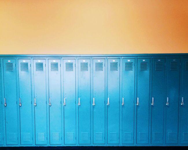 Blue lockers on an orange wall