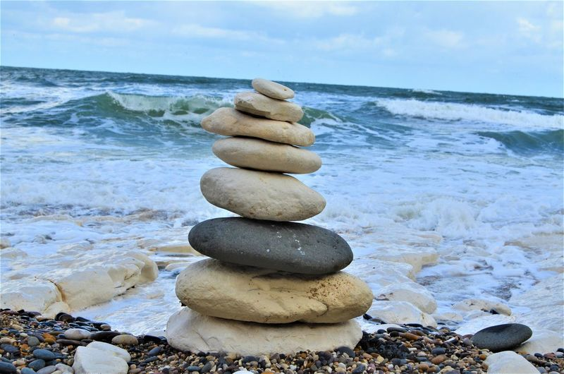 Rock Solid Stack Balance Water Rock - Object Stone Stone - Object Sea Pebble Land Beach Beauty In Nature Nature Tranquility Sky Horizon Horizon Over Water Scenics - Nature No People Outdoors Stack Rock