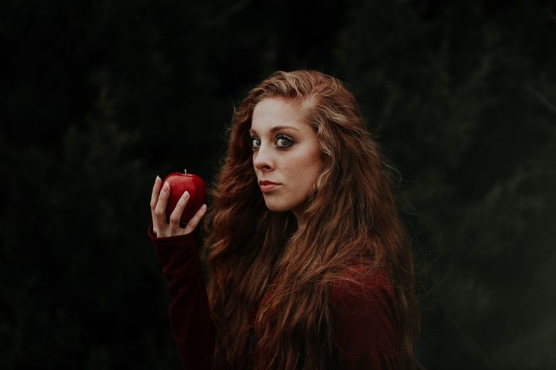 Wanna bite? Redhead Red Apple EyeEm Selects Young Adult Young Women Red Looking At Camera One Person Real People Long Hair Portrait Lifestyles Leisure Activity Beautiful Woman Black Background One Young Woman Only Outdoors Day Close-up Adult People