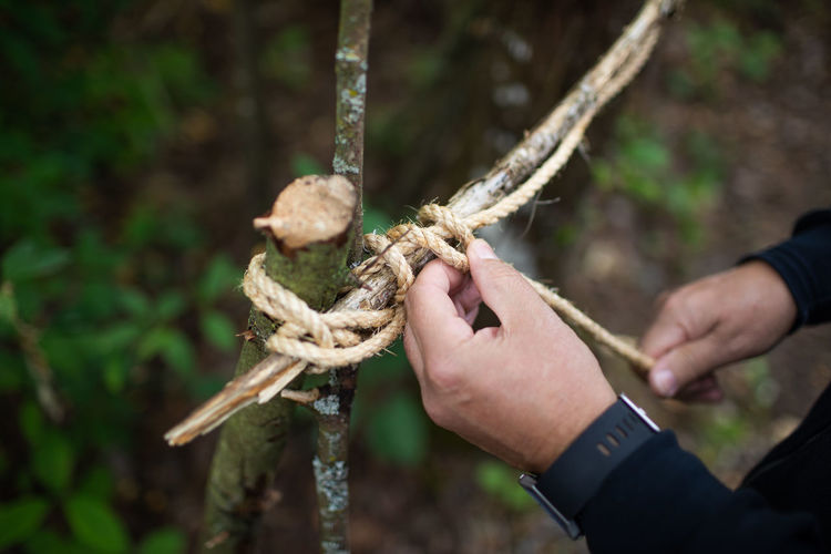 Close-up of person holding rope