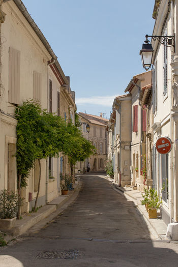 A narrow street at Arles, France Architecture Building Exterior Built Structure Clear Sky Day Diminishing Perspective Empty Footpath Long Narrow No People Old Town Outdoors Signboard Sky The Way Forward Tourism Travel Destinations Vanishing Point