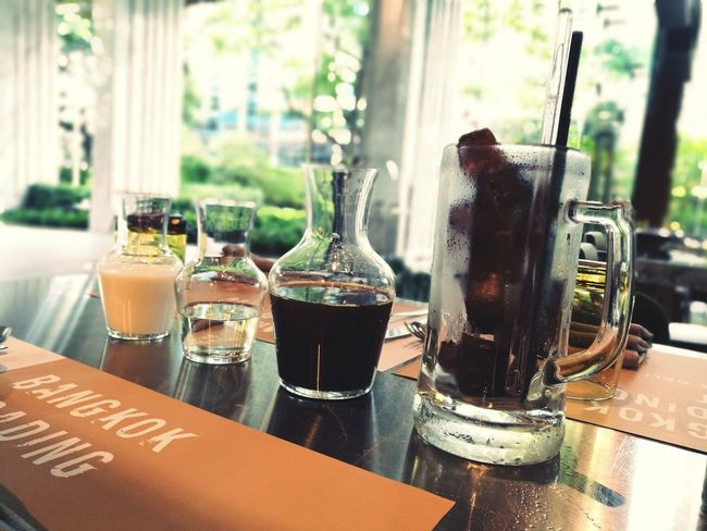 Good morning drink :). Table Indoors  Drink Bottle Window Drinking Glass Food And Drink No People Day Refreshment Cafe Alcohol Close-up Freshness ıced Coffee Coffee Time Coffee