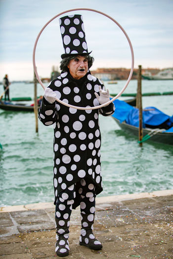 Carnival Carnival In Venice Venice, Italy Carnival Masks Costume Day Focus On Foreground Full Length Lifestyles Looking At Camera Mask - Disguise Nature One Person Outdoors Portrait Real People Sea Sky Standing Venetian Mask Water