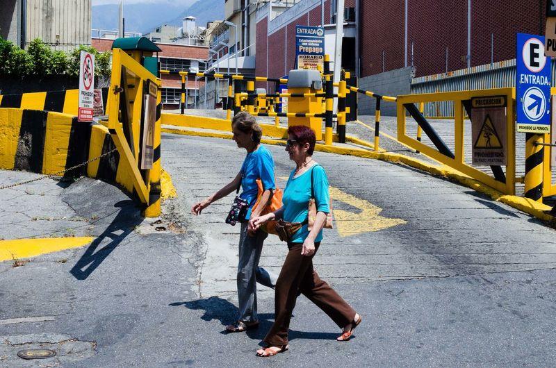Men walking on road in city