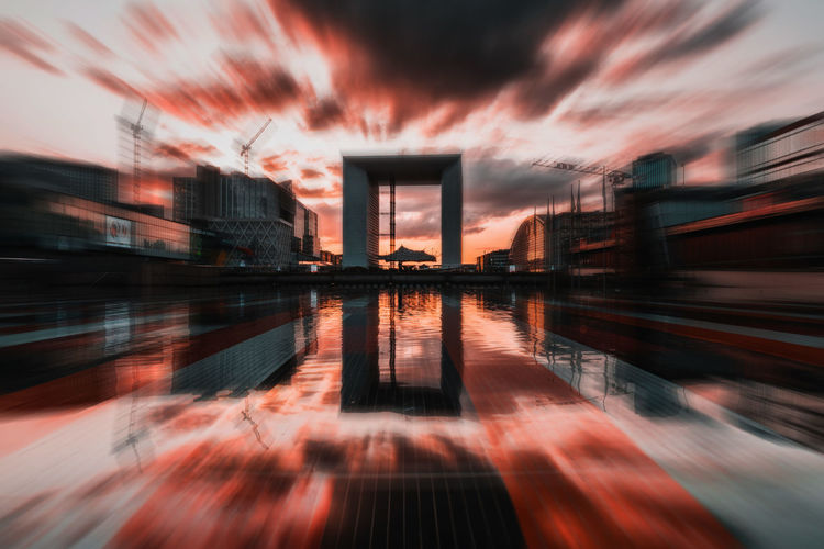 Architecture Blurred Motion Building Building Exterior Built Structure City Cloud - Sky Digital Composite Dusk Long Exposure Motion Nature No People Office Building Exterior Orange Color Outdoors Reflection Sky Sunset Water Waterfront