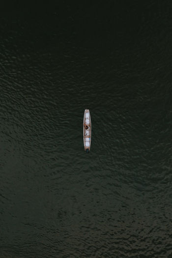 High angle view of fisherman in the boat
