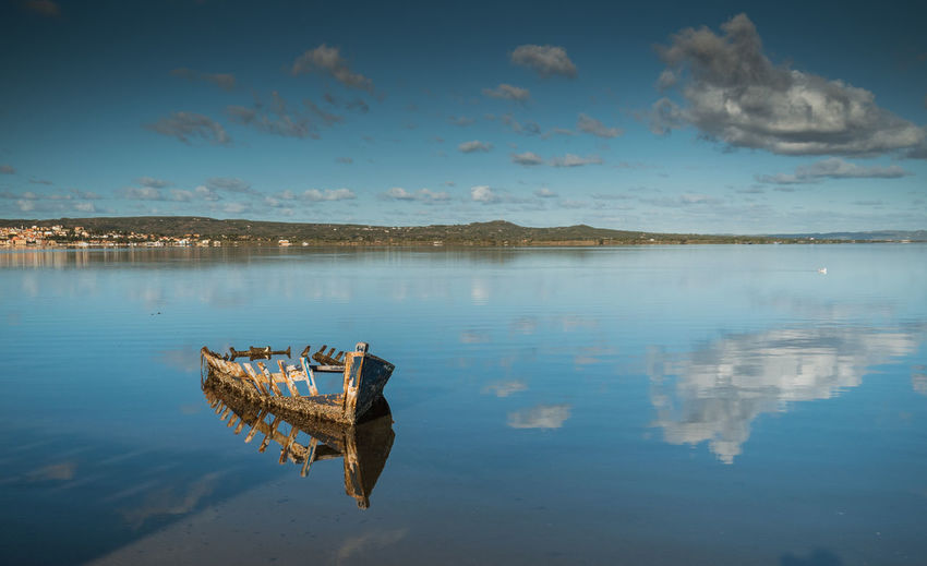Boat in the water. fishing boat in the calm waters of the pond  santa caterina in southern sardinia