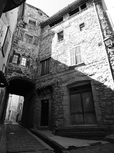 Abandoned Architecture Black And White Blackandwhite Building Exterior Built Structure Damaged Day Deterioration Discarded Façade France Photos Long Low Angle View Messy Narrow No People Obsolete Outdoors Provence The Way Forward Walkway Weathered Window Worn Out