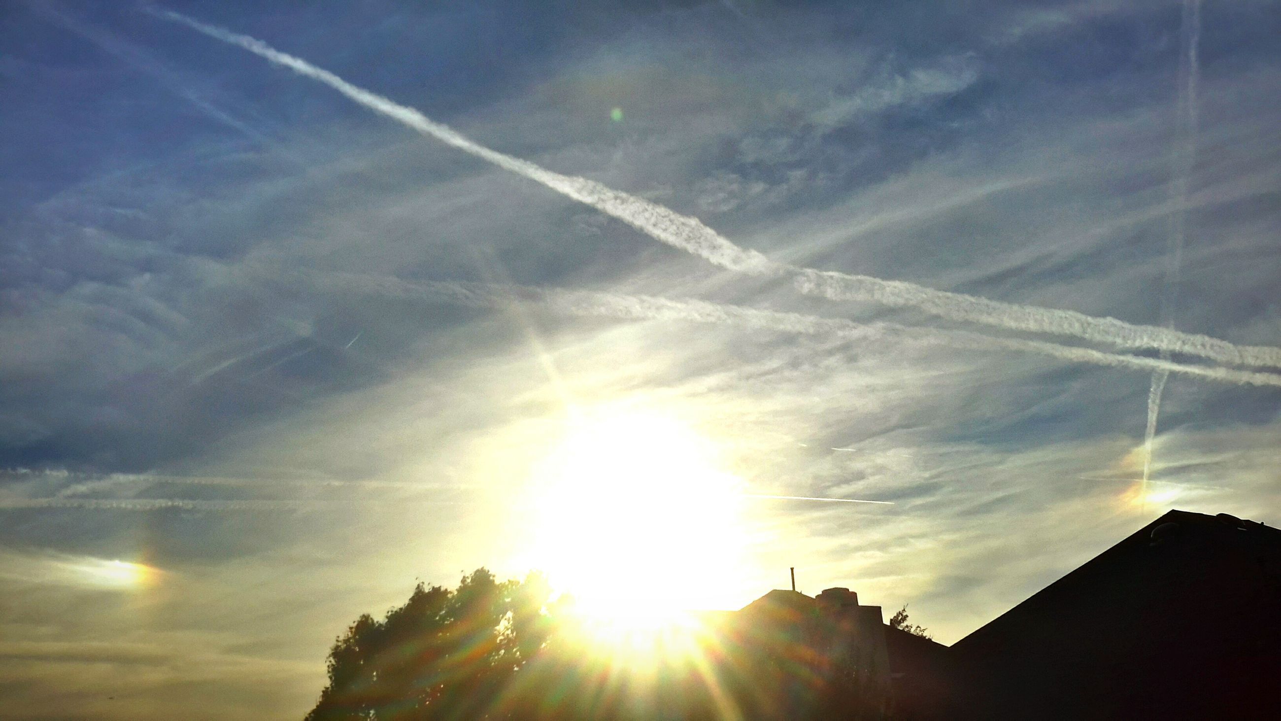 sun, sunbeam, lens flare, sunlight, low angle view, built structure, sky, building exterior, architecture, silhouette, bright, vapor trail, cloud - sky, sunset, sunny, nature, outdoors, beauty in nature, cloud, day