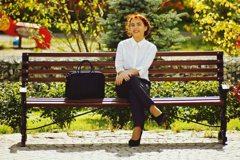Portrait of woman sitting on bench