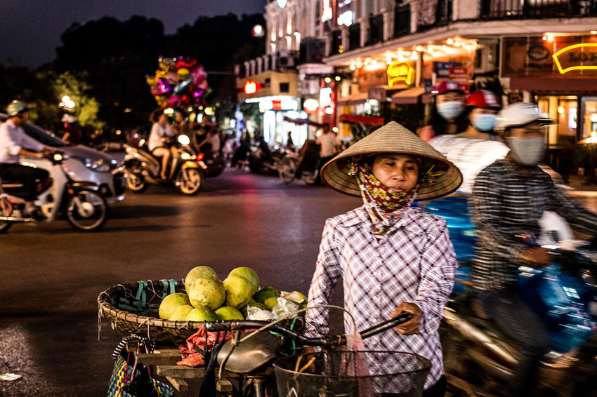 Hanol Streets by night | Vietnam. Adult Asian Style Conical Hat City Food And Drink Fruit Hat Ligth Motorcycle Night Outdoors People Portrait Real People Small Business Street Streetphotography The Street Photographer - 2017 EyeEm Awards Woman Woman Portrait Working