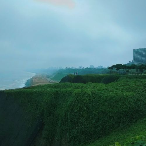 Tiny little people VSCO Panorama #limaperu Cliffs And Sea Bird City Water Tea Crop Agriculture Sky Green Color Grass Cultivated Land Foggy The Great Outdoors - 2018 EyeEm Awards #urbanana: The Urban Playground