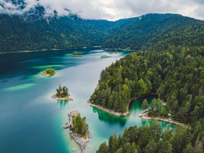 Eibsee lake DJI X Eyeem Drone  Eibsee Aerial View Beauty In Nature Blue Water Cloud - Sky Day Drone Photography Europe Forest High Angle View Idyllic Lagoon Lake Mavic Pro Mountain Mountain Range Nature No People Non-urban Scene Outdoors Plant Remote Scenics - Nature Sky Tranquil Scene Tranquility Travel Destinations Tree Turquoise Colored Water