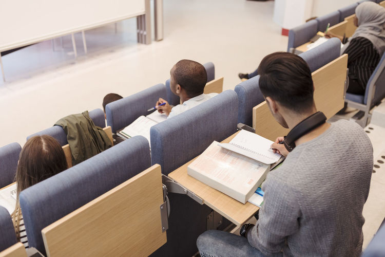 Group of people sitting in classroom