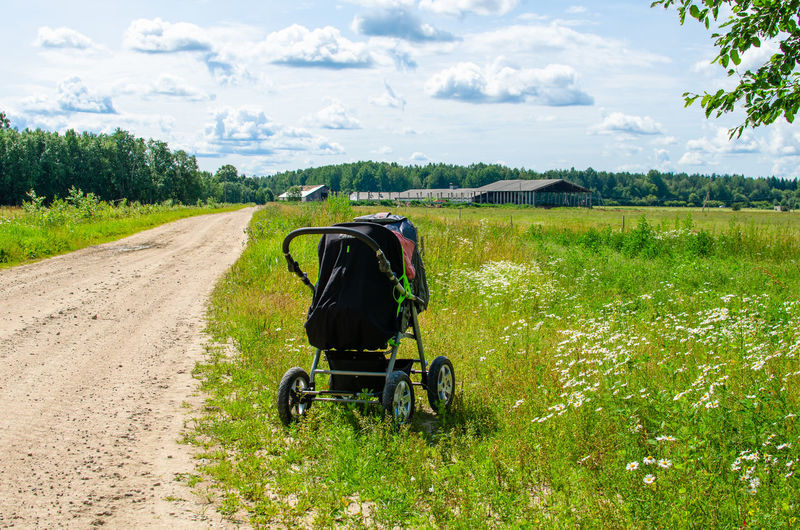 A baby carriage by a rural road in summer, estonia