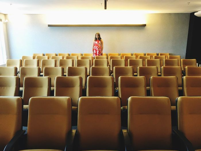 Alone Indoors  Real People Chair One Person Young Adult University Student Seat Casual Clothing Auditorium Women Lecture Hall Leisure Activity Young Women Education University Learning Lifestyles Student One Woman Only Adult