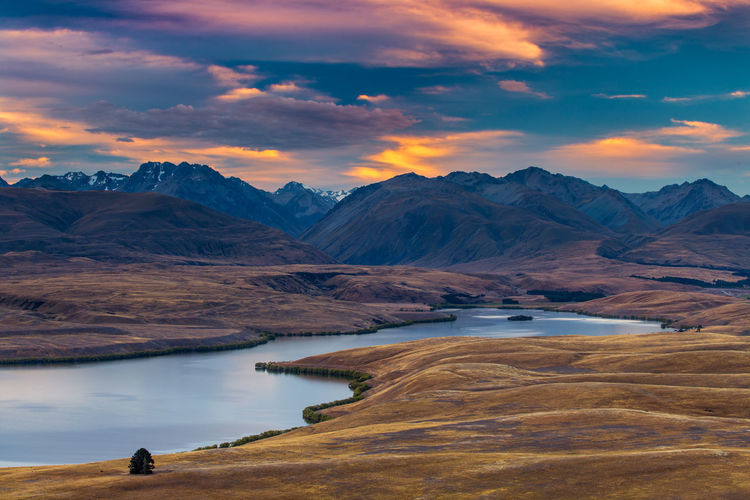 Beauty In Nature Cloud - Sky Environment Idyllic Lake Lake Alexandrina Lake Tekapo Lake View Landscape Mountain Mountain Range Mountains Nature New Zealand No People Non-urban Scene Orange Color Remote Scenics - Nature Sky South Island Sunset Tranquil Scene Tranquility Water