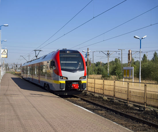New model fast train waiting us in the station Rail Transportation Transportation Track Railroad Track Mode Of Transportation Public Transportation Cable Train Sky Electricity  Train - Vehicle Railroad Station Platform Nature Land Vehicle Railroad Station No People Passenger Train Day Power Line  Sunlight Outdoors Power Supply Station Railroad Car