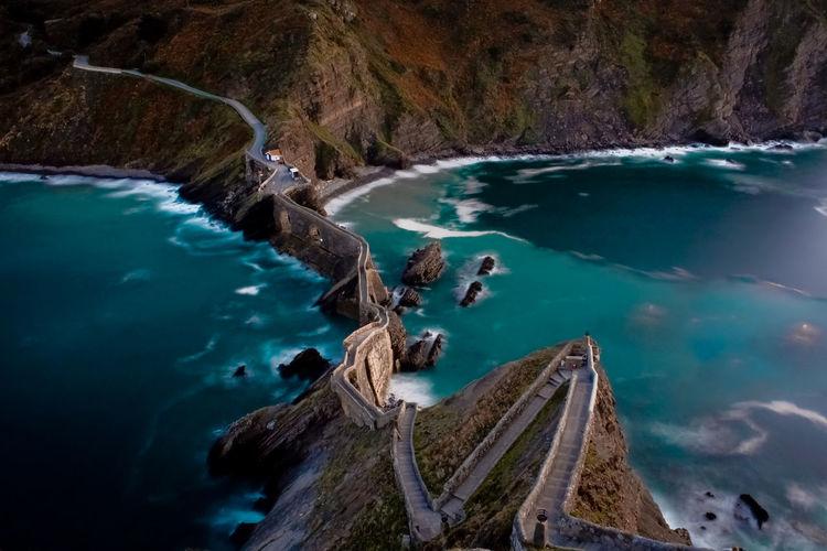 Scenic view of bridge on cliffs