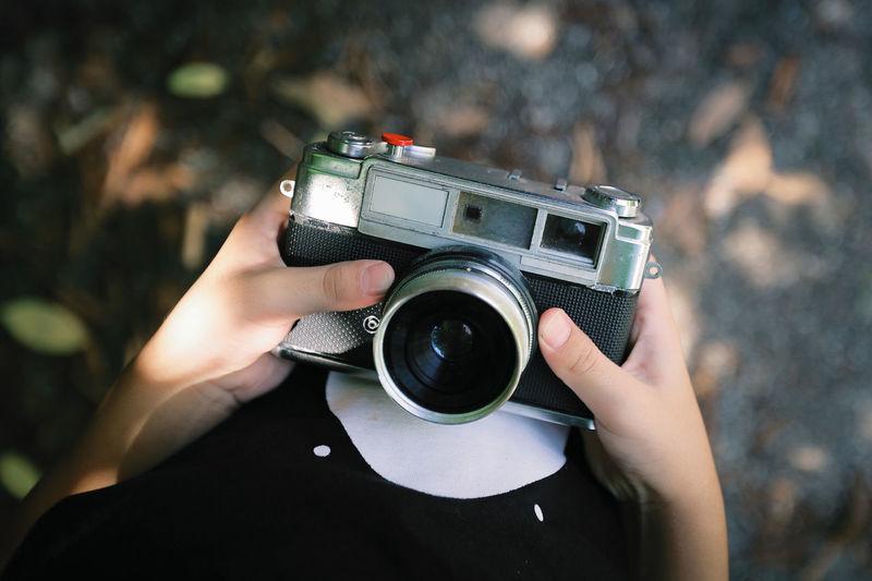 Boy hand holding a beautiful vintage camera