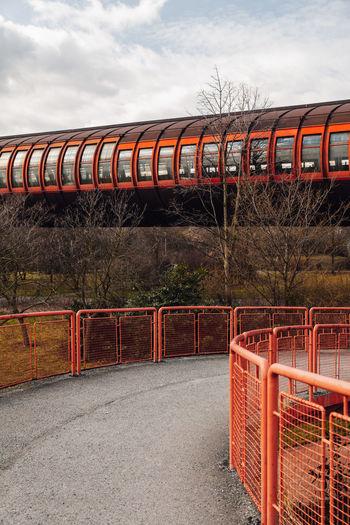 Train on bridge against sky
