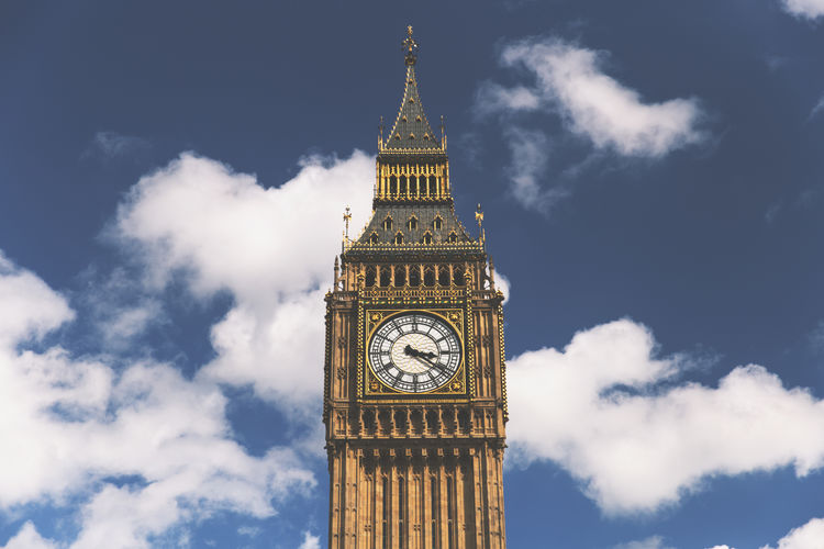 Low Angle View Of Big Ben Against Cloudy Sky