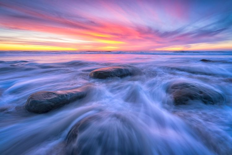 Going with the Flow Motion Sunset Beauty In Nature Long Exposure Scenics - Nature Water Sea Blurred Motion Sky Solid Rock - Object Cloud - Sky Nature Dramatic Sky Landscape Beach Outdoors