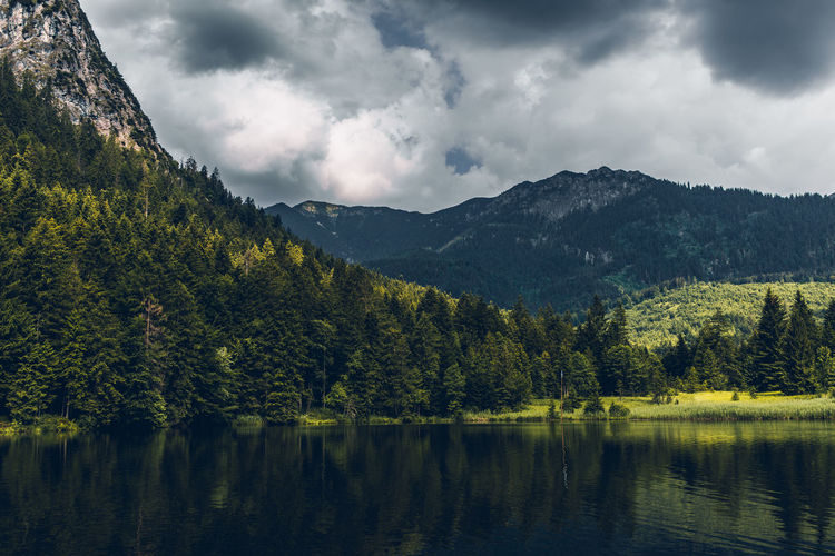 Mountain lake near Garmisch-Partenkirchen, Bavaria, Germany EyeEm Best Shots Nikon D610 Alps Beauty In Nature Cloud - Sky Dramatic Clouds Environment Forest Garmisch-partenkirchen Germany Idyllic Lake Mountain Mountain Lake Mountain Range No People Plant Reflection Sky Tamron 35 Mm Tranquil Scene Tranquility Tree Water Waterfront My Best Travel Photo Autumn Mood