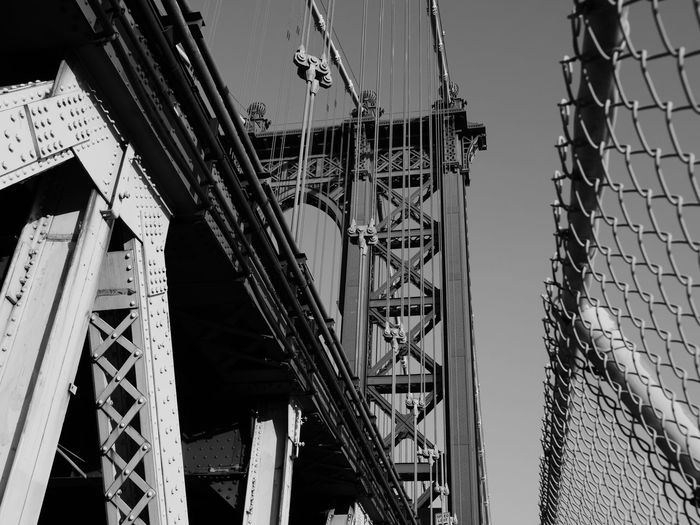 NYC NYC LIFE ♥ NYC Photography NYC Street NYC Street Photography NYC Bridge Architecture Black And White Photography Bridge - Man Made Structure Building Exterior Built Structure City Connection Day Engineering Girder Low Angle View Manhattan Bridge No People Outdoors Sky Suspension Bridge Transportation Water