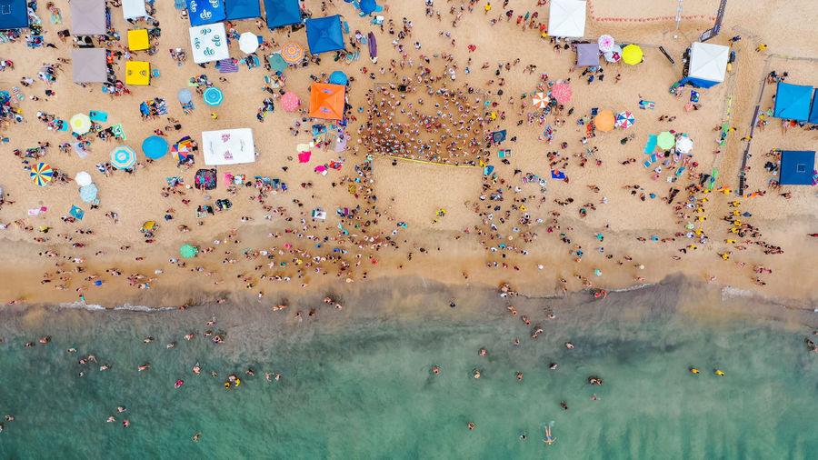 Aerial view of people enjoying on beach