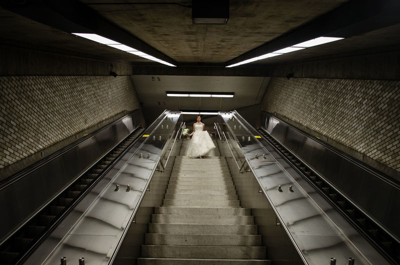 Low angle view of bride walking on steps